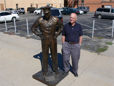 Ronald beside statue of Eisenhower in Rapid City