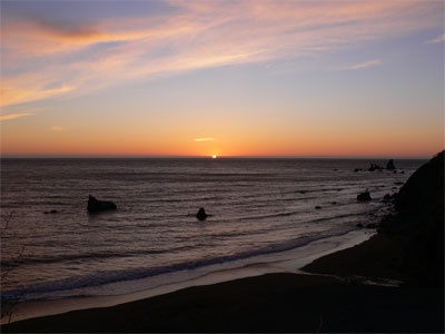 The sun sets over the Pacific off the California coast