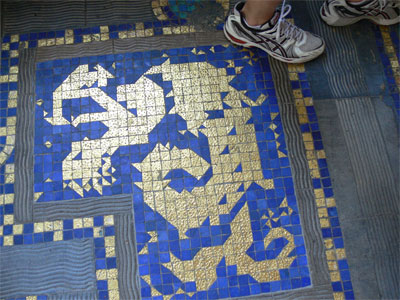 inlaid gold flakes in floor tiles