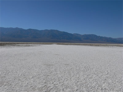 Walkway out onto the salt flat. The white trail is where people have tamped down the salt, and the gray border is where no one has walked.